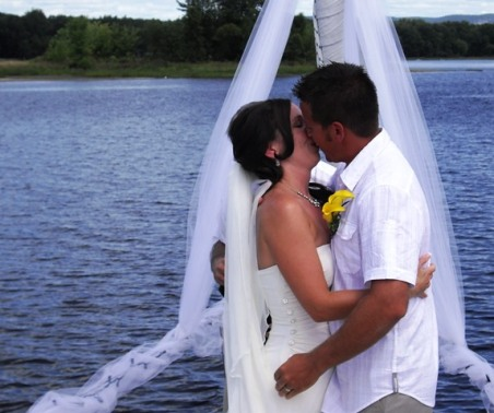 A kiss on the bow of their sailboat on the Ottawa River