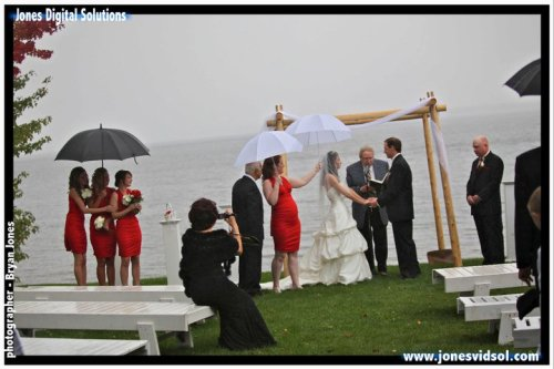 Nobody looks happy with a wedding in the rain