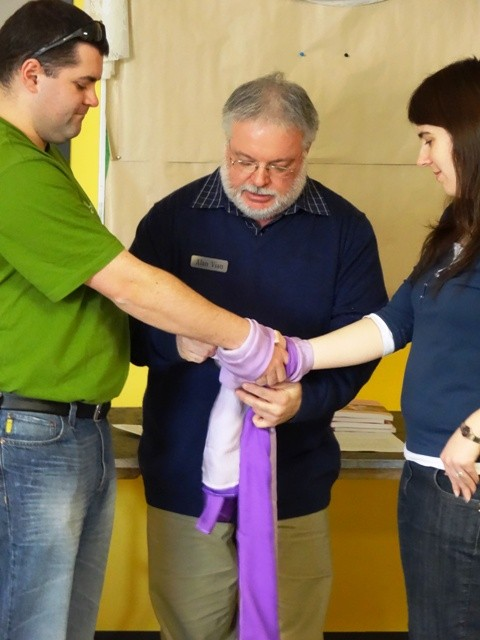 Demonstrating how a handfasting is done.