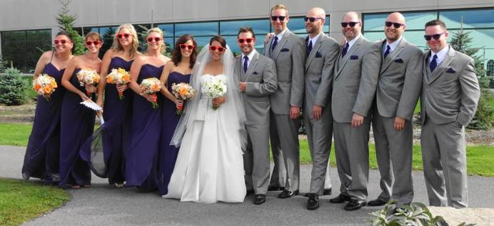 The color of the men's ties match the girls' dresses.
