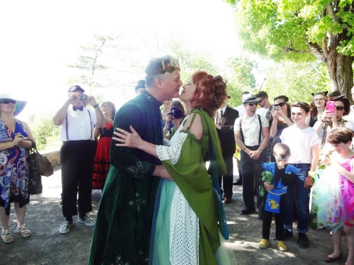 Costumed wedding kiss