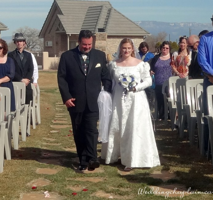 My brother-in-law and niece walking down the aisle in Colorado