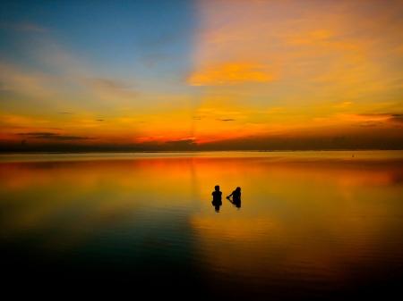 Vivid Balinese sunset over sea. ©kevinummel/Budget Travel